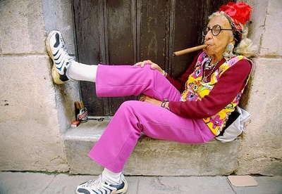 Old lady with cigar in weird clothes