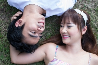 Couple laying on the ground pre wedding