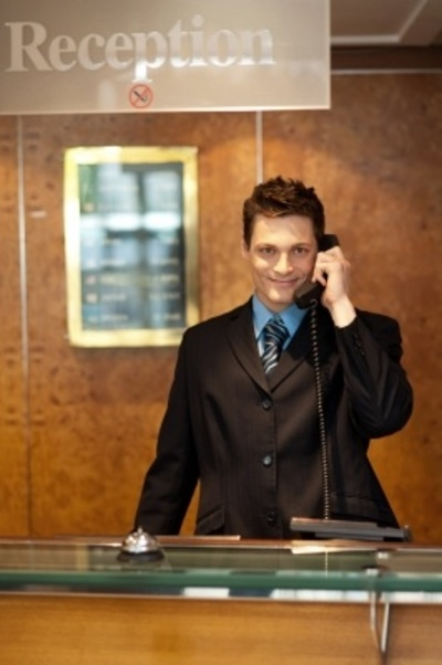 Man at reception on phone